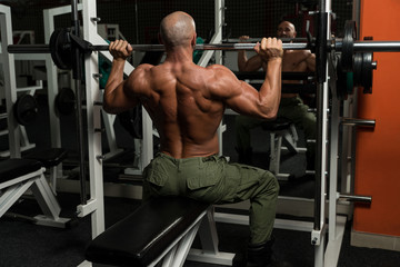 Healthy Mature Man Doing Exercise For Shoulder