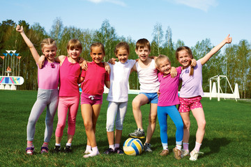 Portrait of seven little children with balls