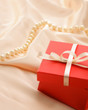 gift on red silk satin background
