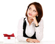 business woman with gift box with red bow sitting at the desk