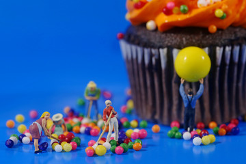 Plastic People Cleaning Up a Messy Cupcake