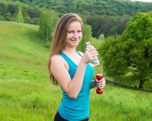 Sport, exercise and healthcare - sporty girl with water bottle.