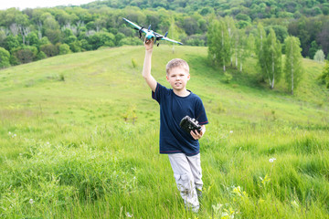 Smiling young boy preparing to launch RC plane.
