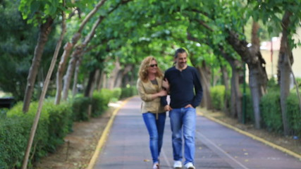 Happy couple walking in park