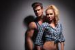 young muscular man looking away near girlfriend