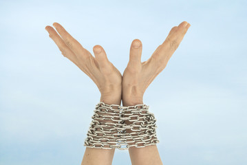 Chained hands and sky