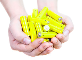 Caucasian handful with lot penlight batteries isolated on white
