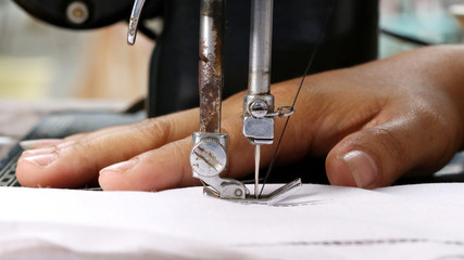 Woman hand, working with sewing machine