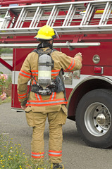 Lowering the ladder rack on a Roseburg fire engine at a drill
