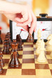 Woman playing chess, close up