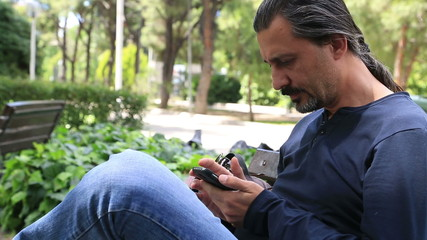 Man Using a Smartphone in park