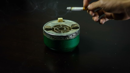 Time lapse man hand smoking and cigarette burning