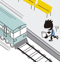 電車が近づくのに気がつかずスマートフォンをする男性