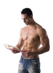 Muscular shirtless male bodybuilder reading book
