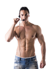 Muscular shirtless helpdesk operator with headset