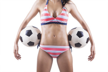 Beautiful body of female soccer fan in bikini