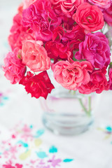 fresh beautiful tea roses on a table.