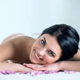 Enjoying pampering that enhances her beauty poster