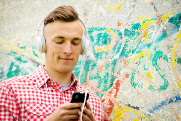 Hip young man listening to music