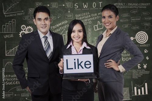 Business team showing like on laptop