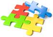 vier Puzzleteile bunt