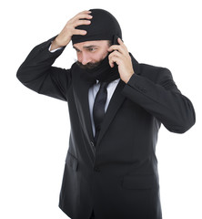 Adult man wearing balaclava on phone isolated on white