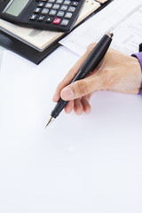 Businessman using pen to pointing copy space