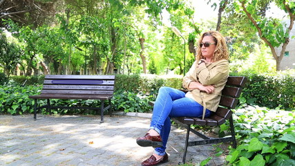 Sad woman waiting in park