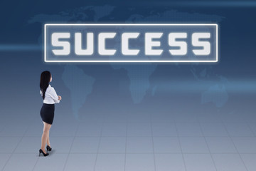 Businesswoman and success concept on blue world map