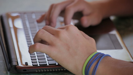 Writing on laptop, male hands