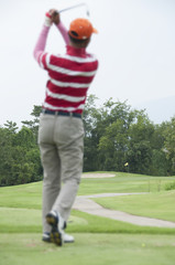 Tee shot in golf course.