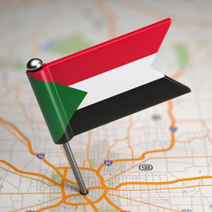 Sudan Small Flag on a Map Background.