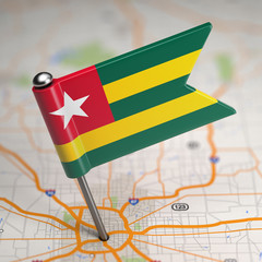 Togo Small Flag on a Map Background.