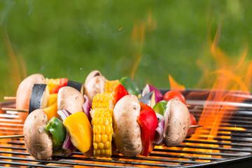 Grilled vegetarian skewers on fire