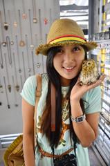 Portrait Thai woman with Owl Doll