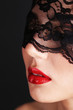 Girl with red lips and openwork black eye shades