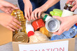 People makes foodstuffs out of donation box on grey background - 65106311
