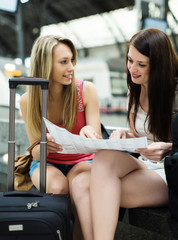 women with baggage and map