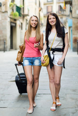 Two european students smiling on street