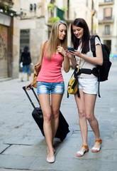 Two european students on vacation with luggage