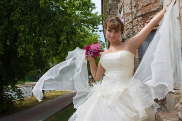 beautiful bride near the old church