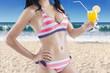 Woman wearing sexy bikini with fresh drink