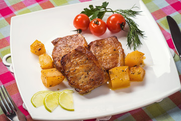 Baked pork loin and potatoes with spices