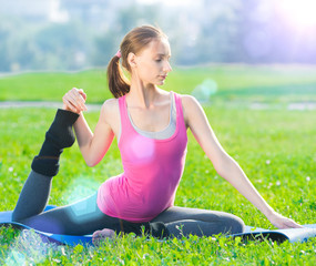 Woman doing stretching fitness exercise. Yoga postures