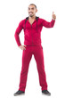 Young sportdman in red suit   thumbing up isolated on white