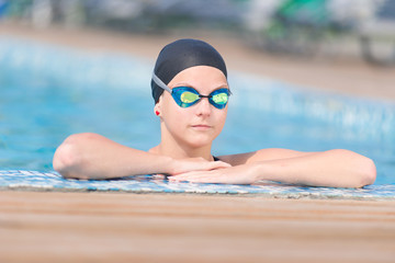 Female swimmer in blue water swimming pool. Sport woman.