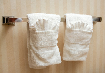 Towels hanging on a handle