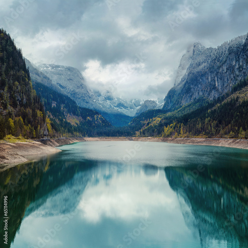 Alpine lake with dramatic sky and mountains. Tirol, Austria