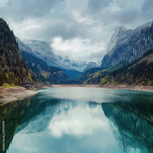 Deurstickers Alpen Alpine lake with dramatic sky and mountains. Tirol, Austria
