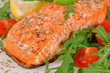 Grilled salmon with arugula and tomatoes